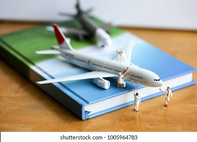 Miniature people : worker clean  air plane using for business trip concept.