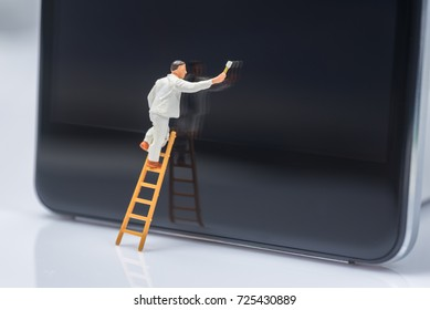 miniature people worker cleaning smart phone screen