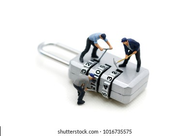 Miniature people: Worker hacking in  padlock security. concept for data security breach, risk and hacker attack.