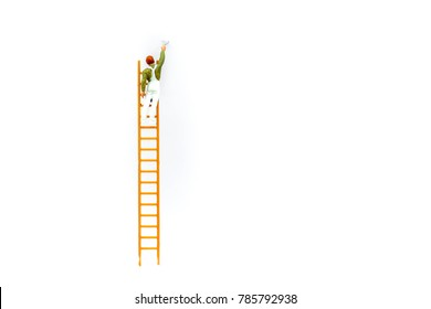Miniature people: Worker with ladder on white background and copy space using as background business concept.