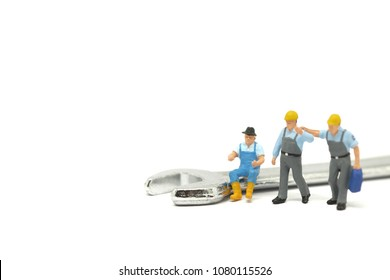Miniature people, worker man going to start maintenance work sales service. Picture use for service customer concept or background international labor day's concept.