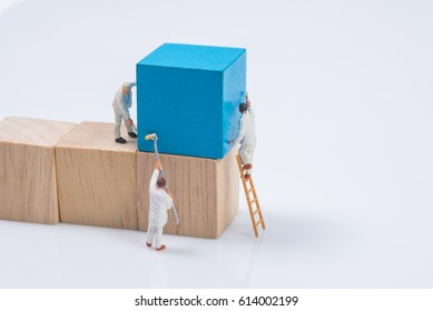 miniature people worker painting wood cube building block