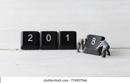 miniature people worker teamwork holding computer keyboard button 2018 new year concepts