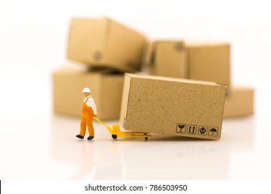 Miniature people: Worker use pallet truck with the boxs using as background business of warehouse concept.