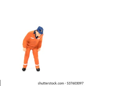 Miniature people worker wearing safety construction concept on white background with a space for text