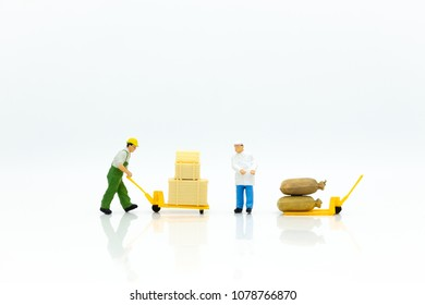 Miniature people: Workers are carrying boxes for transporting goods to destination. Image use for transportation, logistic , supply chain concept