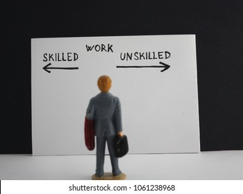 Miniature person businessman worker employee skilled versus unskilled work topic.