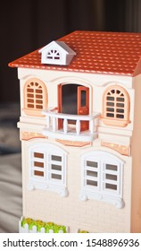 Miniature plastic dollhouse. House model. Toy for children.