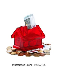 Miniature red house with money, concept