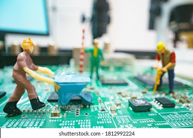 Miniature repair man on mainboard, Miniature figure of worker team try to repair cpu on mainboard.