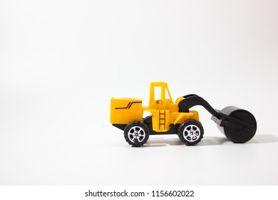Miniature road roller isolated white background side view.
