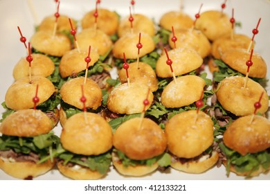 Miniature roast beef sandwiches with cranberries