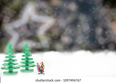Miniature of Santa Claus with children on star lights background.