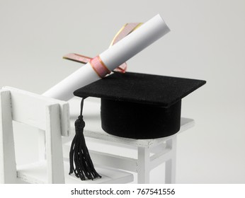 miniature school table and chair and mortar board