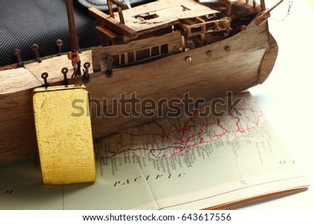 c1d68abd2ec8 Miniature scratch build junk ship wooden model and gold bar put on the old  paper map