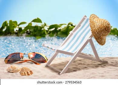 Miniature of a sun lounger with sunhat in front of a lagoon, symbolizing relaxation at the beach