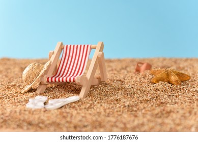Miniature sunbed on the beach, vacation in the sun.