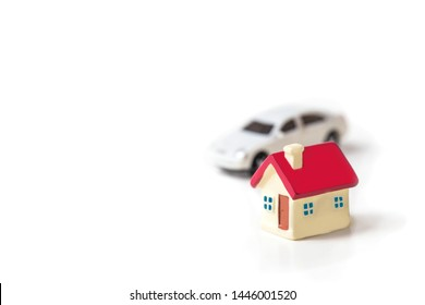 miniature toy house and car isolated on white background, image for real estate concept.