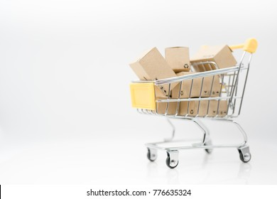 Miniature toy: Shopping cart and box isolated on white background , business , shopping concept.