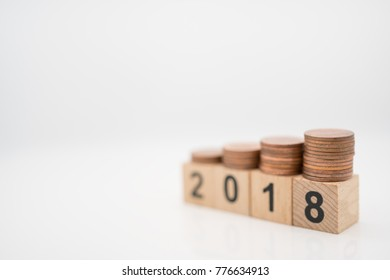 Miniature toy: wood block with 2018 and stack of coin on it , business ,financial, Success, Business Growth concept.