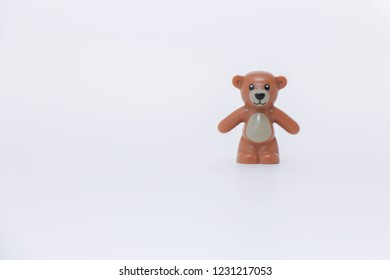 miniature toys. brown bear good New Year spirit. white pass through phot on photo. play toys. new year concept