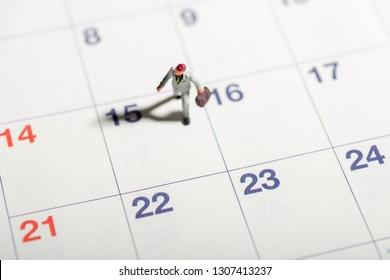 Miniature toys concept of tax filing deadline.