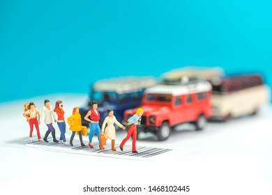 Miniature toys a group of women crossing a road - road safety concept.