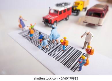 Miniature toys school kids walk on cross road bar code - school children road safety concept.