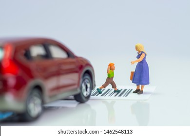 Miniature toys school kids walk on cross road bar code - school children road safety concept -  side view