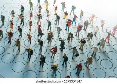 Miniature toys - social distancing conceptual image, people distancing each other in public places to avoid infection.