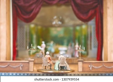 Miniature toys watching theater performance. Scene made of vintage figurines