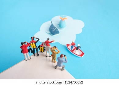 Miniature toys -  whale watching expedition-father and son, scuba divers, photographers and man with binocular.