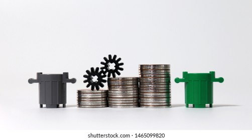 Miniature trash cans and piles of coins. The concept of increasing waste disposal costs.