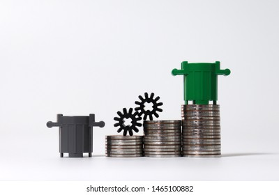 Miniature trash cans and piles of coins. The concept of waste disposal costs.