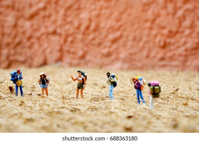 miniature traveler on the field , survey , travel model.