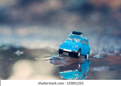 Miniature travelling car with luggage on top. Macro photography