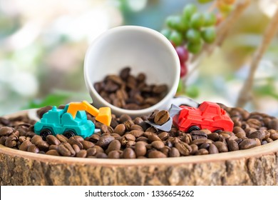 miniature truck with coffee bean and white cup on wooden plate over blurred plantation of coffee tree with sun lighting.