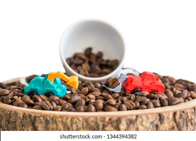 miniature truck with coffee bean and white cup on wooden plate isolated on white