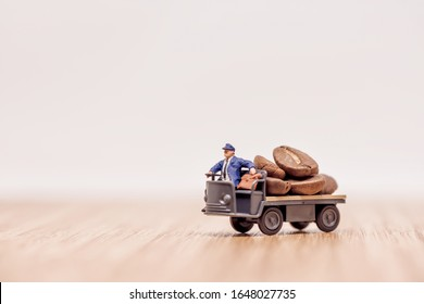 Miniature truck with driver loaded with coffee beans