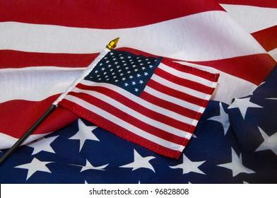 Miniature United States flag on larger flag