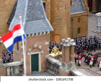 A miniature version of the The Golden Coach which is a coach owned and used by the Dutch royal family. The Gold Coach is used every year on prinsjesdag. Taken in Madurodam, the hague, the Netherlands
