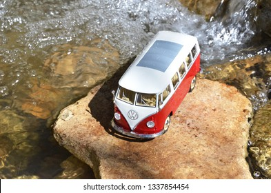 Miniature VW Bulli 1962 in the forest. The cult car of the Hippie generation and it remained the status vehicle of the high wave surfers