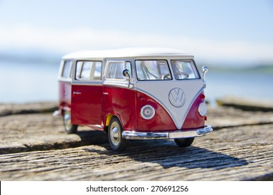 Miniature VW Bulli 1962 on the wooden pier. The cult car of the Hippie generation and it remained the status vehicle of the high wave surfers