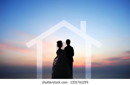 miniature wedding doll model over morning sky background, home mortgage concept