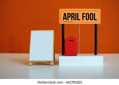 A miniature of white stand and a red mail box with a word April Fool