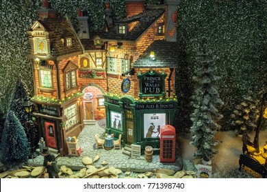 Miniature of winter scene with Christmas house pub, shop, people, trees, Christmas concept.