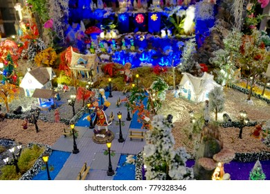 Miniature of winter scene with Christmas houses, people, trees, Christmas concept.