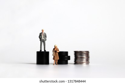 Miniature woman with a miniature man. The concept of equal opportunity and condition demands in labor.