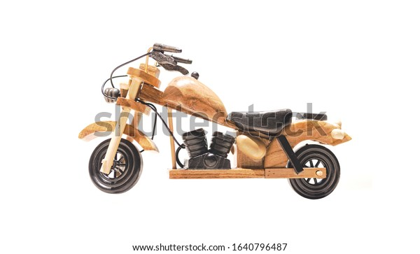 Miniature wooden motorcycle. Motorbike isolated on a white background. Perfect gift for kids or motorbike lovers.