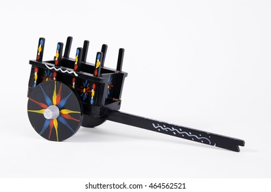 Miniature wooden oxcart in black with colorful decoration